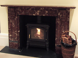 Canterbury Stone and Marble Renovated Victorian Antique fireplace on a newly constructed ceramic and steel chimney system