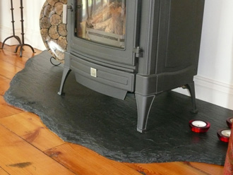 "Freeform ""Riven Black"" slate hearth with a balanced flue ""Nestor Martin"" gas fire"