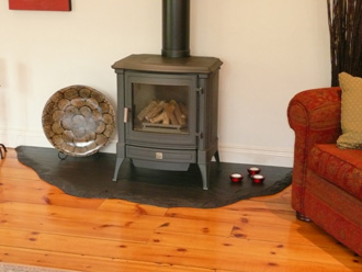"Canterbury Stone and Marble Freeform ""Riven Black"" slate hearth with a balanced flue ""Nestor Martin"" gas fire"