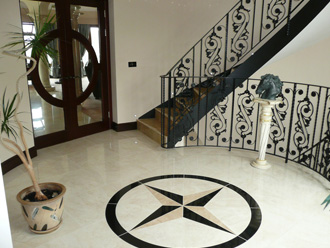 "Polished limestone with a ""Madura Gold"" granite staircase"