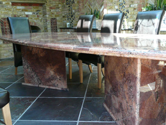 "Canterbury Stone and Marble Commissioned ""Juperano Bordeaux"" on a slate floor"