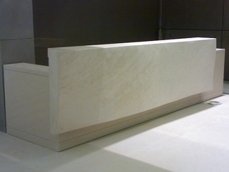 "Canterbury Stone and Marble Commissioned ""Rosal"" limestone reception desk, incorporating a freeform undulating front"
