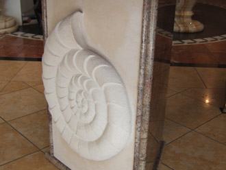 Canterbury Stone and Marble Hand carved Limestone shell, intergrated as part of a granite table leg